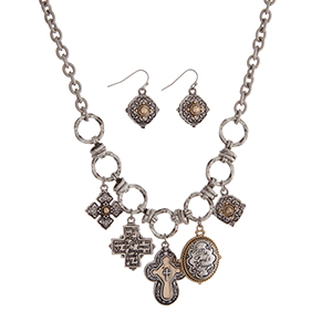 "Burnished silver tone necklace set with two tone cross charms and a charm stamped ""The Lord's Prayer"". Approximately 18"" in length."