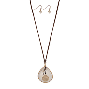 "Adjustable brown cord necklace set displaying a white teardrop shape pendant with a cluster of faux pearls and a gold tone seashell. Approximately 24"" in length."