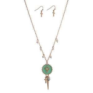 "Gold tone necklace set displaying a mint cross disk with a cluster of beads, a cross charm, and a spike. Approximately 18"" in length."
