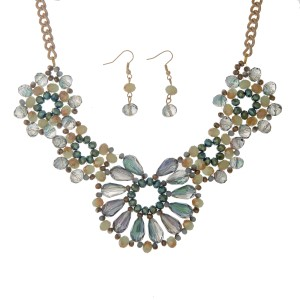 """Gold tone necklace set displaying a floral shape with green and beige glass beads. Approximately 15"""" in length."""