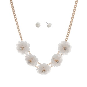 """Gold tone necklace set displaying five white flowers with rhinestone accents. Approximately 17"""" in length."""
