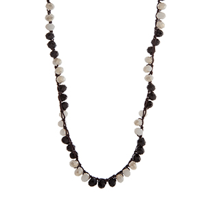 """Black and ivory glass bead crochet necklace. Approximately 33"""" in length."""