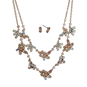 """Worn gold tone layering necklace set displaying peach and ivory flowers with iridescent and peach rhinestone accents. Approximately 20"""" in length."""