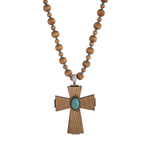 "Brown wood and turquoise bead necklace displaying a wood cross with a turquoise stone focal. Approximately 33"" in length."