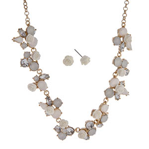 "Gold tone necklace set displaying ivory roses surrounded by multiple shaped mint cabochons. Approximately 17"" in length."