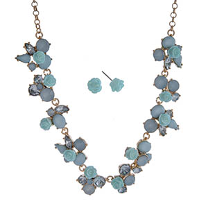 """Gold tone necklace set displaying blue roses surrounded by multiple shaped blue cabochons. Approximately 17"""" in length."""