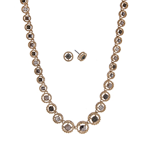 "Gold tone necklace set displaying displaying clear, gray, and black diamond round rhinestones. Approximately 16"" in length."
