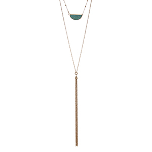"Gold tone double layer necklace with a turquoise crescent pendant and a chain tassel. Approximately 32"" in length."