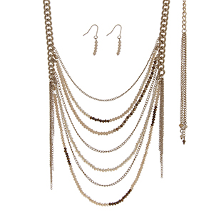 "Gold tone necklace set with ivory and brown beaded chains. Approximately 30"" in length."