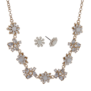 """Gold tone necklace set with white flowers accented by clear rhinestones. Approximately 16"""" in length."""