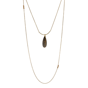 """Gold tone double layer necklace with a tiger's eye teardrop pendant accented with champagne glass beads. Approximately 32"""" in length."""