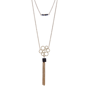 "Dainty gold tone double layer necklace with black beads and a natural stone pendant with a chain tassel. Approximately 36"" in length."