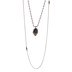 "Gold tone double layer necklace with a gray natural stone pendant accented with gray beads. Approximately 32"" in length."