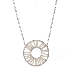 """Silver tone necklace with a wire wrapped circle pendant with white pearl beads. Approximately 32"""" in length."""