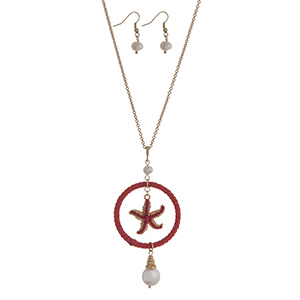 """Gold tone necklace set with a coral suede wrapped circle and starfish pendant accented with Mother of Pearl beads. Approximately 32"""" in length."""