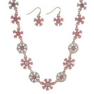 """Gold tone necklace seat featuring white and pale pink flowers with matching earrings. Approximately 16"""" in length."""
