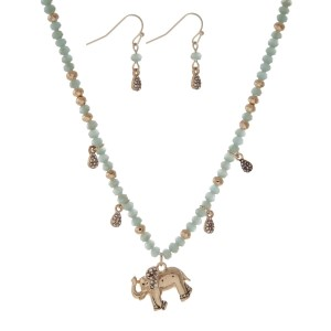 """Gold tone necklace set with gray beads and an elephant pendant. Approximately 18"""" in length."""