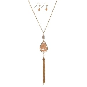 """Gold tone necklace set with a freshwater pearl bead, peach beaded teardrop, and a chain tassel. Approximately 32"""" in length."""