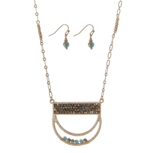 """Gold tone necklace set featuring a half circle pendant accented with turquoise beads. Approximately 32"""" in length."""