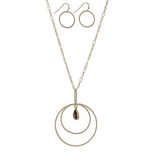 """Gold tone necklace featuring a circle pendant with a tigers eye teardrop natural stone. Approximately 32"""" in length."""