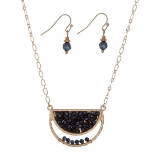 """Gold tone necklace set with a half circle shape and hematite beads. Approximately 16"""" in length."""
