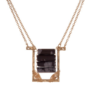 """Dainty gold tone necklace with a rectangle pendant and black beads. Approximately 16"""" in length."""