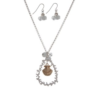 """Silver tone necklace set with a two tone seashell and coral reef teardrop pendant, accented with a white opal bead. Approximately 18"""" in length."""