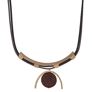 """Black and white cord, double layer necklace with a gold tone geometric pendant and brown circle stone. Approximately 18"""" in length."""