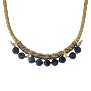"""Braided cord necklace with gold tone wire wrapped navy blue faceted beads. Approximately 14"""" in length."""