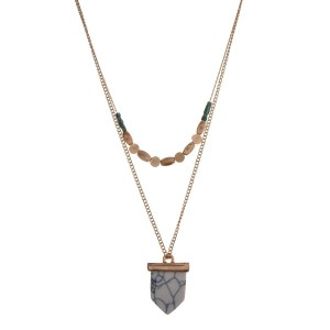 """Gold tone double layer necklace with a howlite stone and green square beads. Approximately 32"""" in length."""