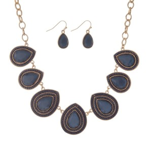 """Gold tone necklace set with navy blue teardrop stones and fishhook earrings. Approximately 16"""" in length."""
