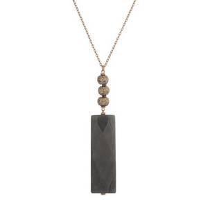 "Gold tone necklace with pave beads and a faceted gray natural stone rectangle pendant. Approximately 32"" in length."