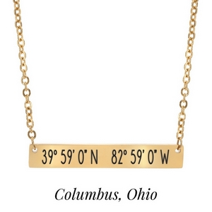 "Gold tone necklace with a bar pendant stamped with the coordinates of Columbus, Ohio. Approximately 18"" in length."