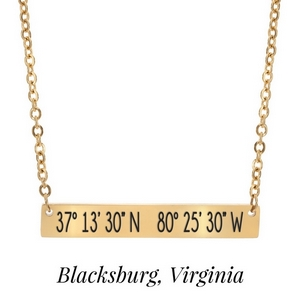 "Gold tone necklace with a bar pendant stamped with the coordinates of Blacksburg, Virginia. Approximately 18"" in length."