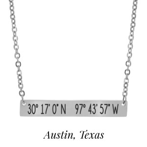 "Silver tone necklace with a bar pendant stamped with the coordinates of Austin, Texas. Approximately 18"" in length."