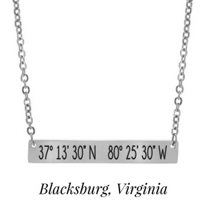"Silver tone necklace with a bar pendant stamped with the coordinates of Blacksburg, Virginia. Approximately 18"" in length."