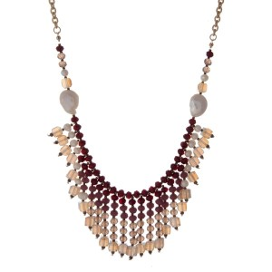 "Gold tone necklace with freshwater pearls, burgundy, purple, and white opal beads. Approximately 32"" in length."