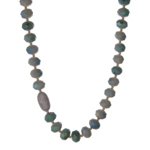 """Light and olive green beaded necklace with gold tone beads and a pave bead focal. Approximately 22"""" in length."""