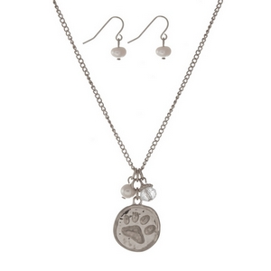 """Silver tone necklace set with a paw print, pearl and clear bead charms. Approximately 16"""" in length."""