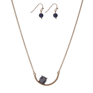 """Dainty gold tone necklace set with a curved bar pendant accented with a blue stone. Approximately 16"""" in length."""