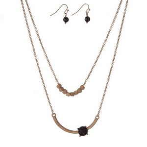 """Dainty gold tone, double layer necklace set with a black stone and gold square beads. Approximately 16"""" in length."""