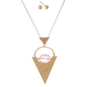 "Gold tone necklace with a hammered gold tone triangle pendant and faceted peach bead. Approximately 32"" in length."