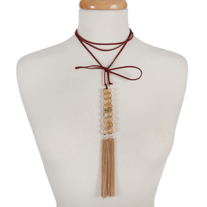"""Burgundy faux suede wrap choker with beige natural stone beads and gold tone chain tassels. Approximately 12"""" in length."""