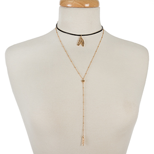 """Black leather choker with a gold tone 'Y' layer and feather pendants. Approximately 12"""" in length."""