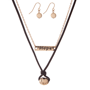 """Genuine leather and gold tone two piece necklace set with a bar focal, stamped with """"Hope."""" Approximately 16"""" in length."""