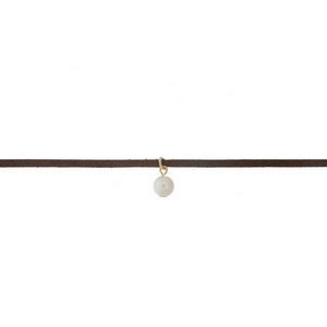 """Brown faux suede choker with a 10mm pearl bead pendant. Approximately 12"""" in length."""