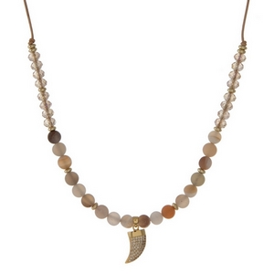 """Brown cord necklace with botswana natural stone beads, topaz faceted beads and a gold tone horn pendant. Approximately 16"""" in length. Handmade in the USA."""
