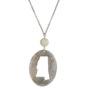 """Burnished silver tone necklace with a Mississippi cutout pendant accented by a pearl bead. Approximately 30"""" in length. Oval pendant is approximately 2.5"""" tall."""