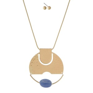 """Gold tone necklace set with a hammered circle pendant and light blue faceted bead. Approximately 32"""" in length."""