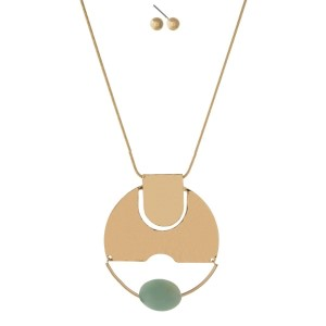 """Gold tone necklace set with a hammered circle pendant and mint faceted bead. Approximately 32"""" in length."""